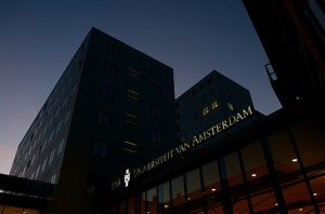 """Universiteit van Amsterdam"" at night"
